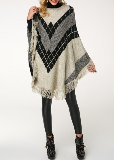 Tassel Embellished Asymmetric Hem High Neck Sweater