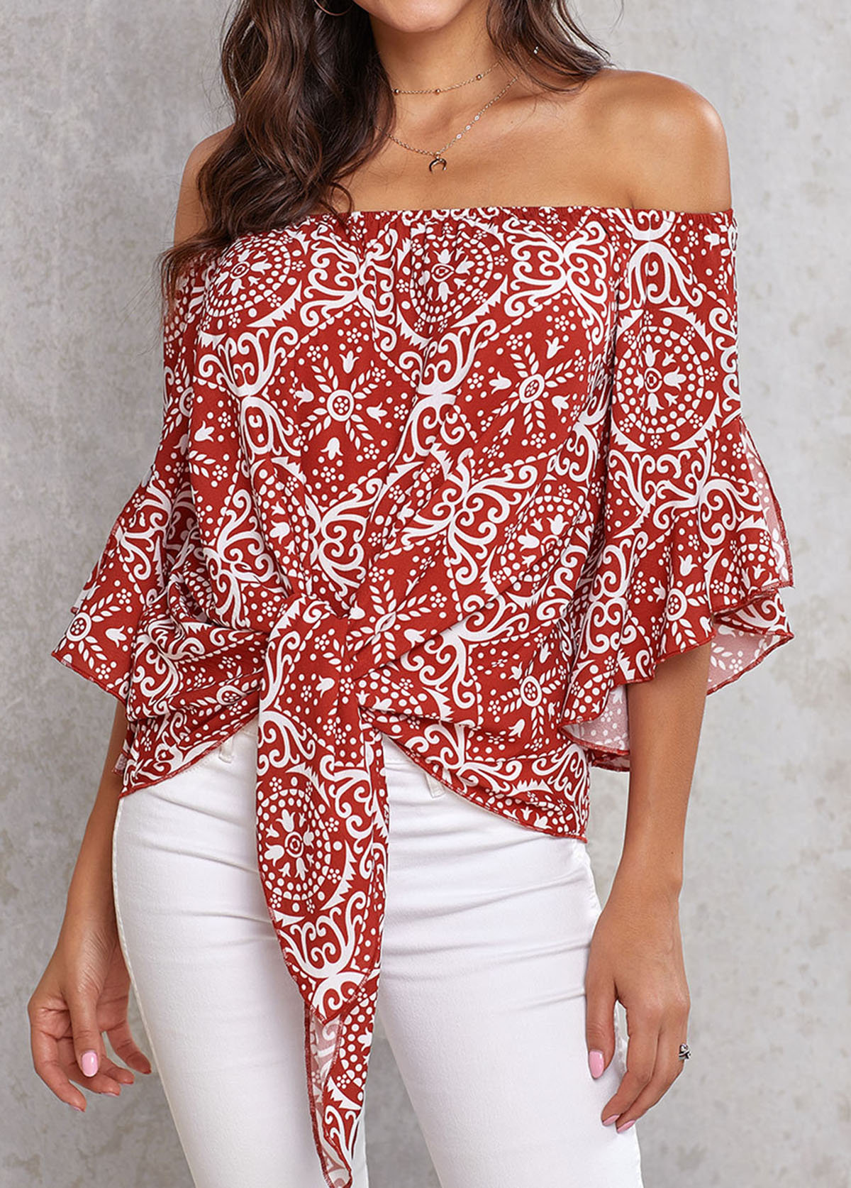 Printed Off the Shoulder Knotted Hem Blouse